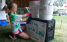 Child refilling with water cooler